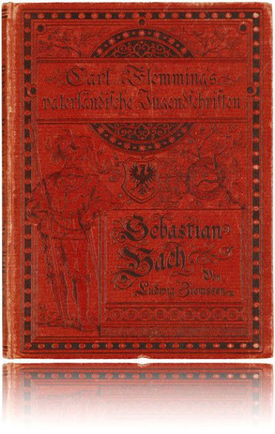 It is an all red biography about Johann Sebastian Bach. The font is black and it is an old font. It says, the author is Carl Flemming. There is a landsquenet visible.