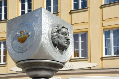 You see the upper part of the Bach monument in Ansbach, Bavaria, Germany. It's silver, it's modern, it's from steel. In the background you see the letters BACH, which actually names the city of Ansbach.